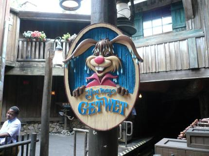 """You May Get wet Sign Splash Mountain Frontierland Magic Kingdom Walt Disney World"" by mrkathika is licensed under CC BY-SA"