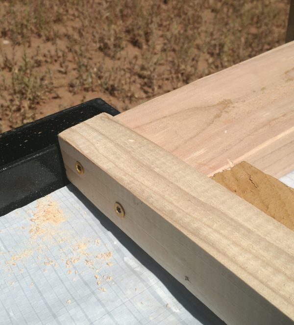 Three pieces of wood nicely dovetailed together & held in place with wood screws.