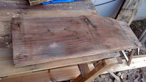 A thick, sturdy, somewhat weatherworn slab of wood, sitting on my worktable.