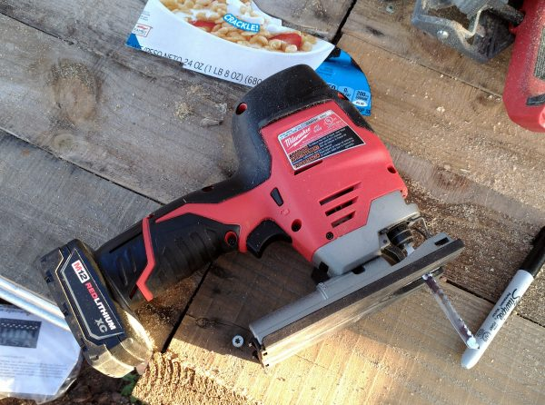 A Milwaukee brand cordless jigsaw. It's really pretty small, & it looks light & disturbingly clean.