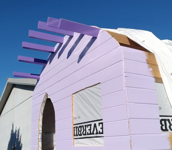 The front of the tinker's wagon, seen slightly from the side. The rafters are now a nice even purple, & about a foot of the side wall has been painted along the corner.