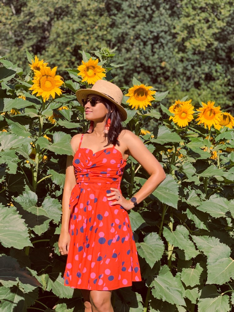 Red polka dot dress and straw hat