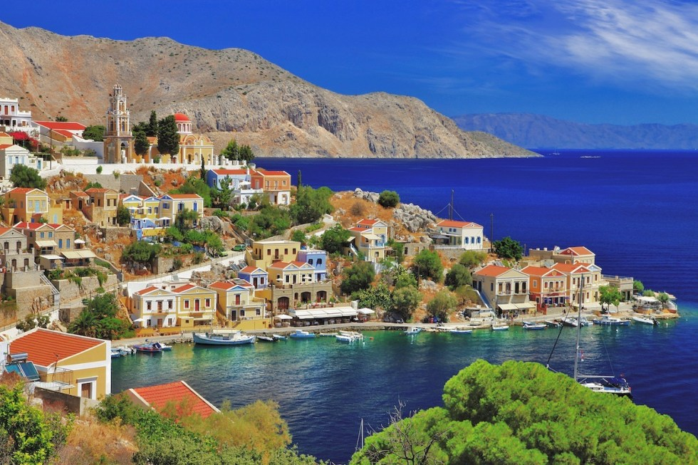 Symi in Greece belongs to the Dodecanese island group and is known for its neoclassical houses at its harbor.
