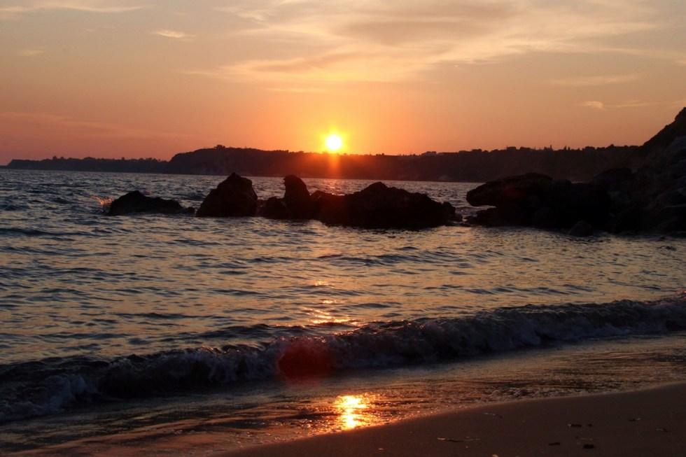 The sun goes down on the Ionian Sea on the Livathos coast.