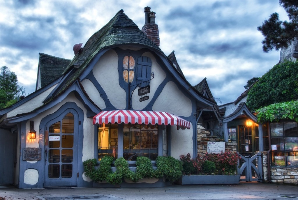 An English fairytale cottage in Carmel-by-the-Sea, California, created by Hugh Comstock, now hosts Tuck Box eatery.