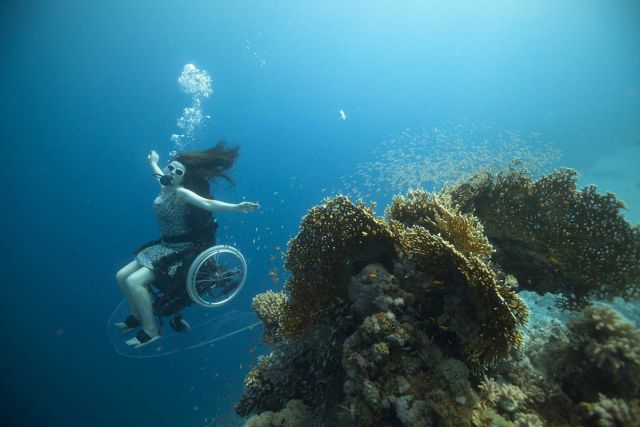 Disabled woman Sue Austin performs using her underwater wheelchair for Creating the Spectacle
