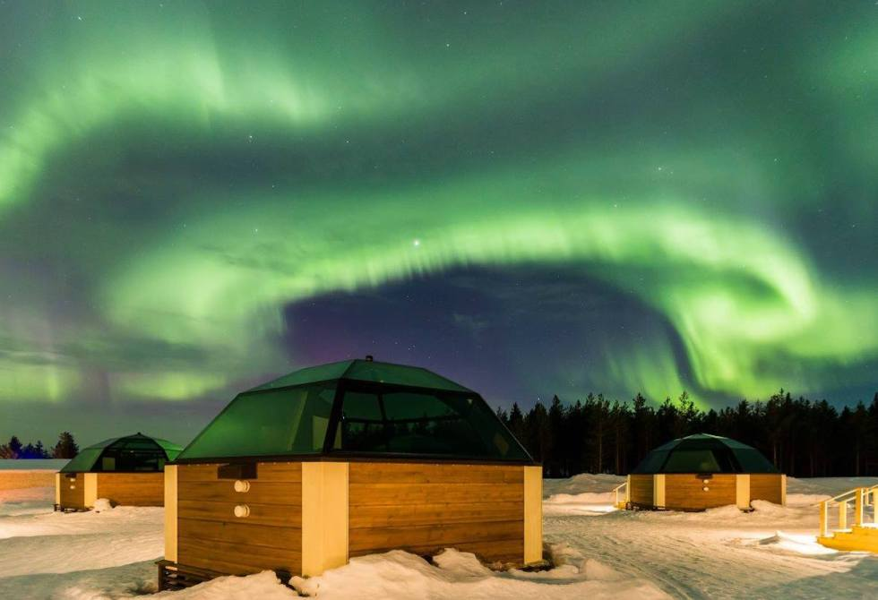 Three of the 39 glass igloos of the Arctic SnowHotel & Glass Igloos in Finland where
