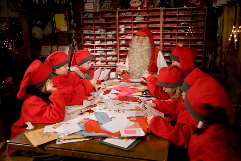 Santa Claus and his elves read letters from around the world at Santa Claus Main Post Office in the Arctic Circle near Rovaniemi, Finland.