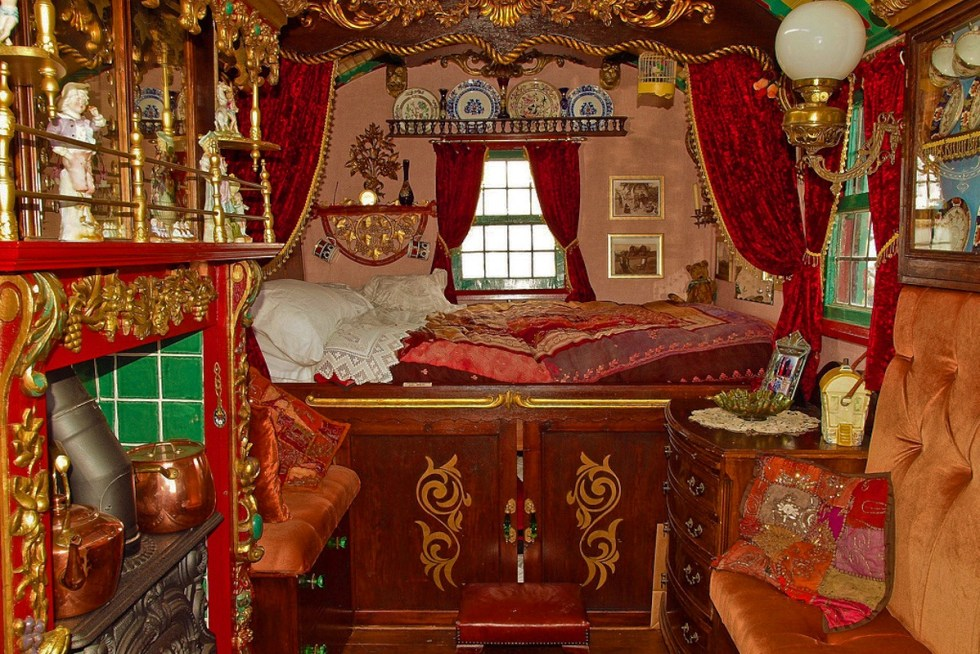 """The intricately decorated interior space of a traditional """"vardo."""""""