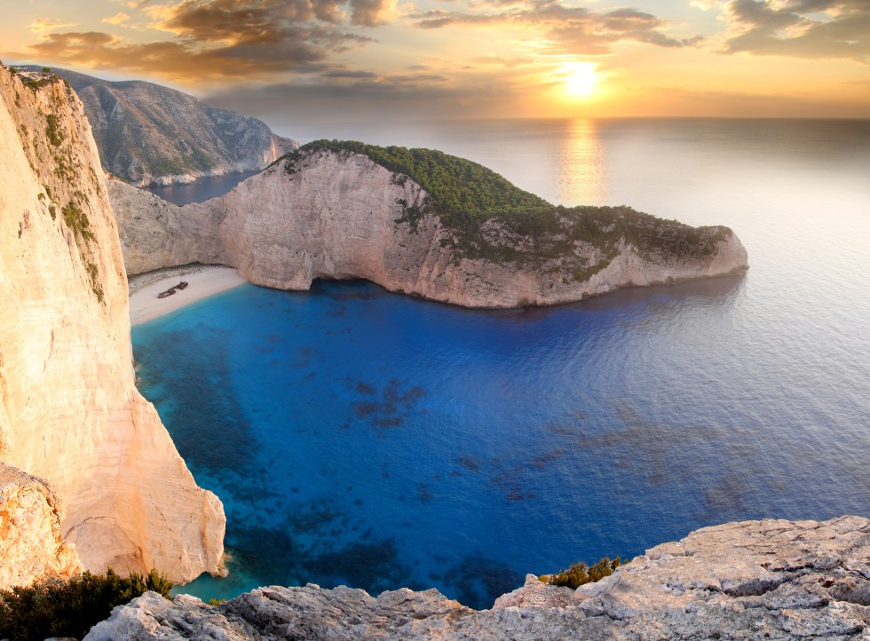 The amazing Navagio (Shipwreck beach) against the sunset in Zakynthos, Greece.