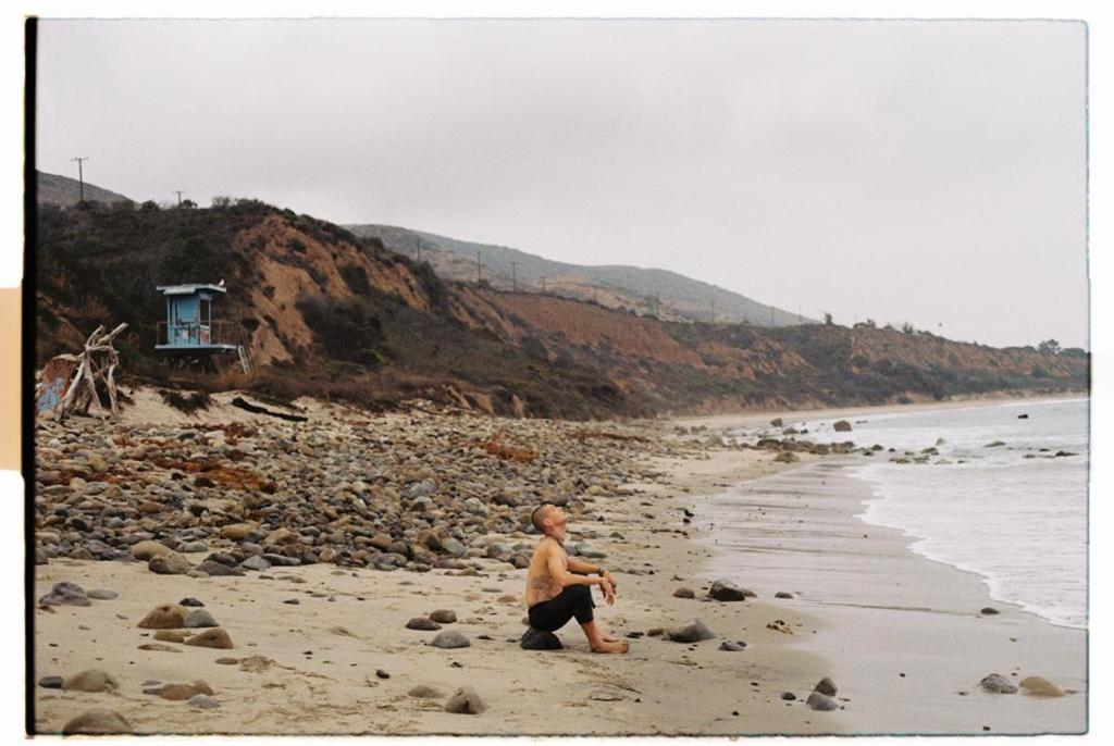 Behind-the-scenes photo of Francesco Cuizza in Malibu, California, during the Warrior with a Crown fashion film shooting.