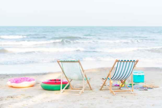 Beach chairs on seashore