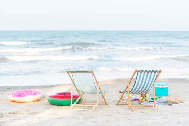 Beach chairs on seashore