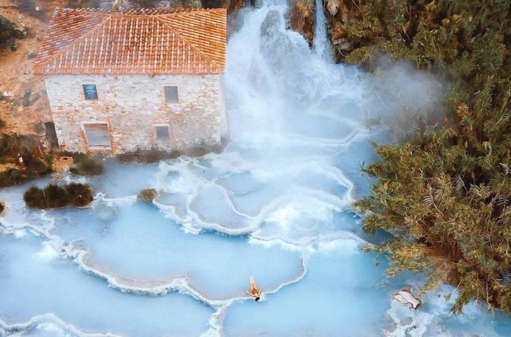 Aerial photo of Cascate del Mulino hot springs in Italy.