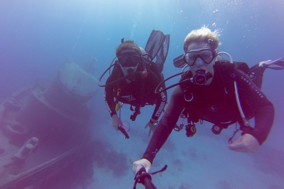 "Scuba divers exploring the wrecks of New Providence island with the ""World's Most Popular Dive Resort"" – Stuart Cove's."