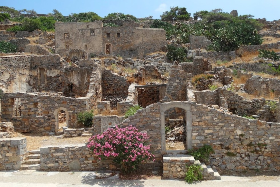 The crumbling buildings of Spinalonga Island in Crete, Greece.