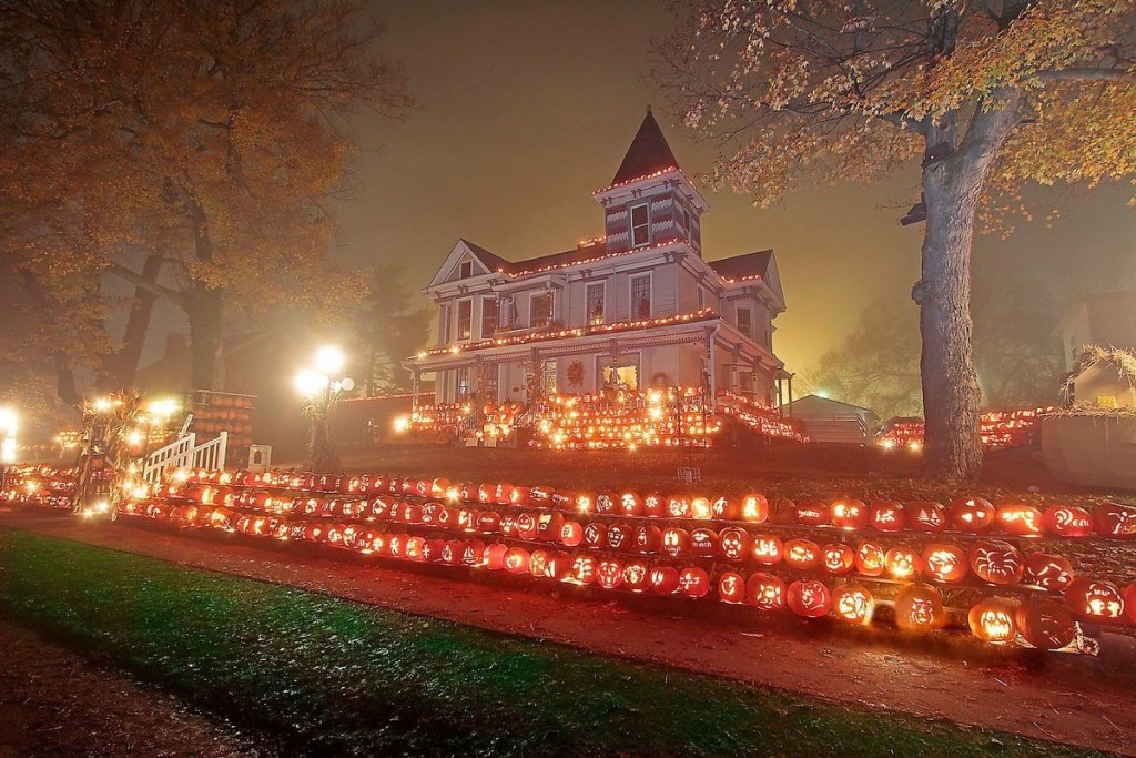 Queen Anne style residence in Kenova, West Virginia, known as Pumpkin House, decorated with jack-o'-lanterns of all shapes and sizes