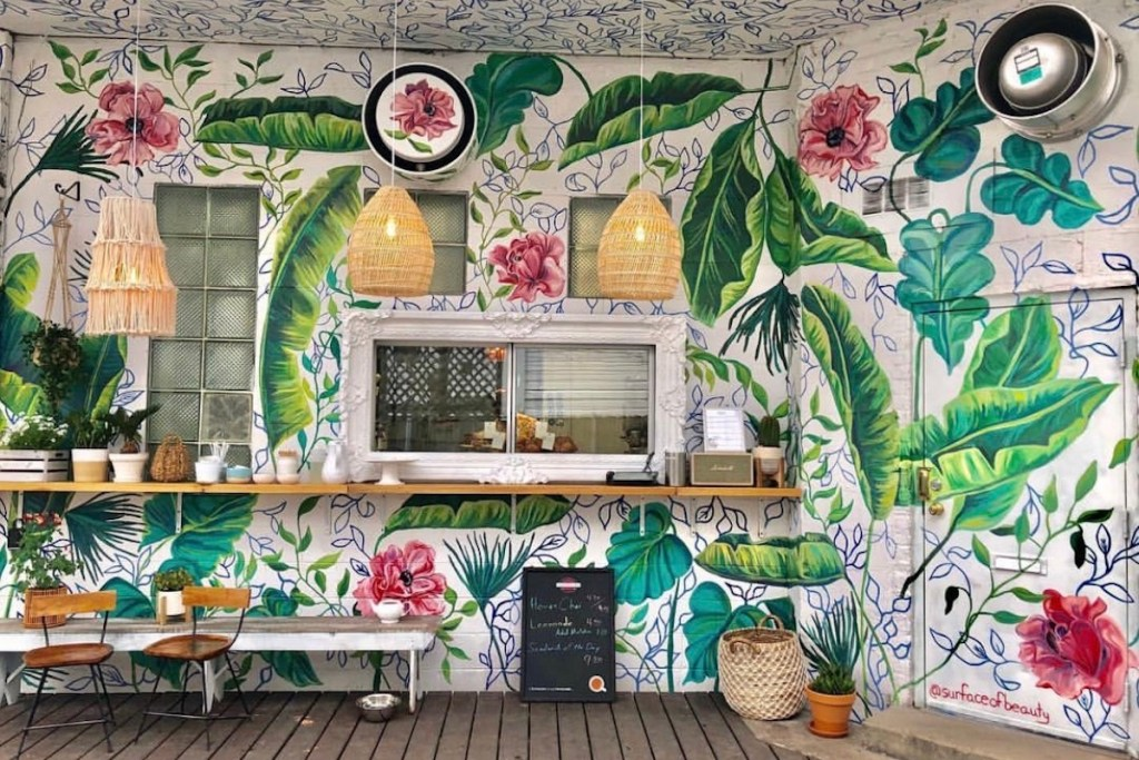 Maison Marcel Lincoln Park To-Go Window exterior painted with bright flowers and lush greenery