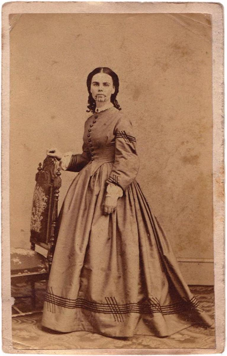 Carte de Visite of Olive Oatman having her chin tattooed with blue cactus ink in thick lines to ensure that she would be recognized as tribal member in the afterlife