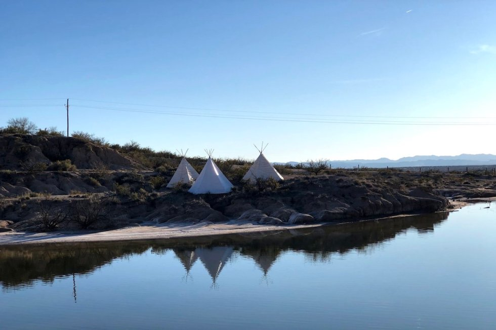 Three Indian teepee tents at Indian Cliffs Ranch
