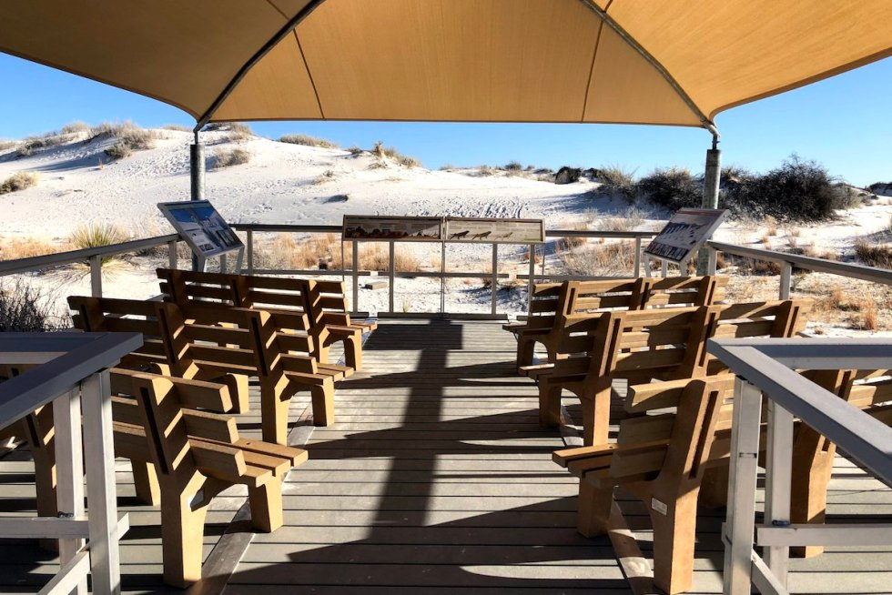 "Shade structure with seating, located midway along the ""Interdune Boardwalk"""