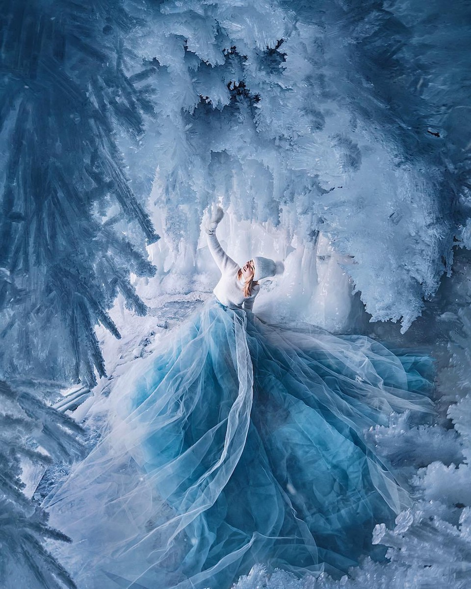 Woman wearing an impressive long skirt photographed by Kristina Makeeva in Lake Baikal, Ruusia