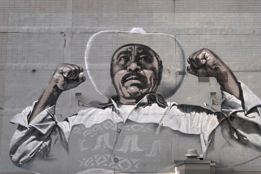 Mural of a Mexican man flexing his muscles