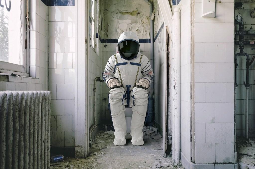 astronaut on a toilet seat