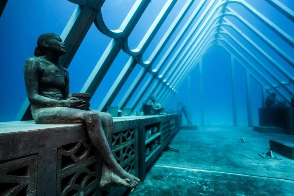 eerie collection of humanlike underwater sculptures