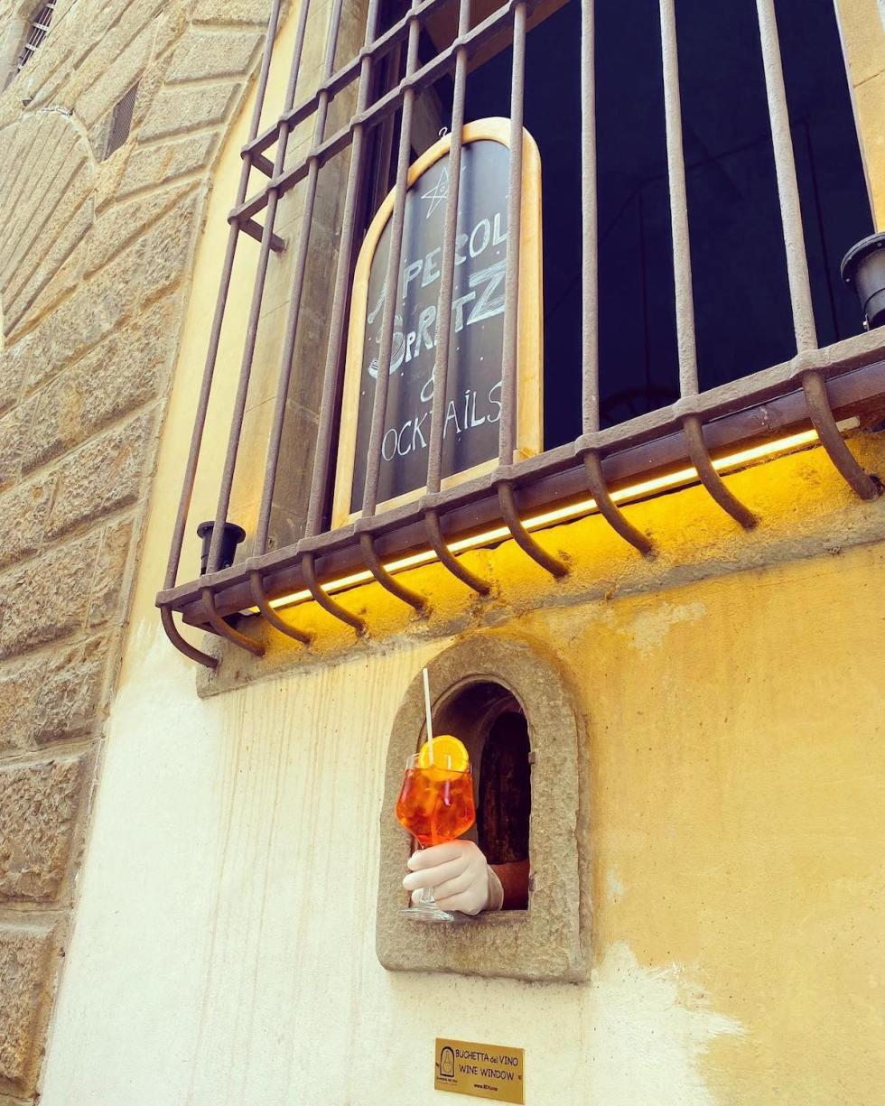 An Aperol Spritz in the Wine Window of the Osteria delle Brache in Piazza Peruzzi