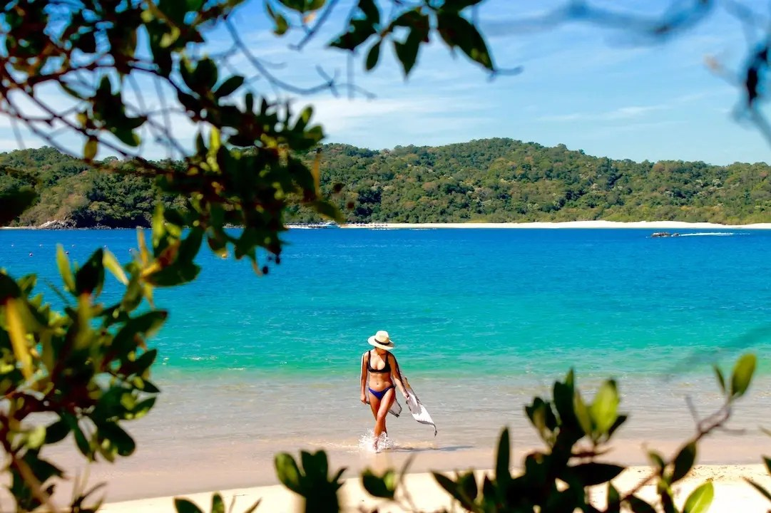 A girl at the beach of Huatulco National Park in Oaxaca