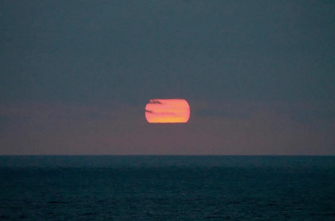 The sun setting over the Pacific Ocean in Ayungue Ecuador