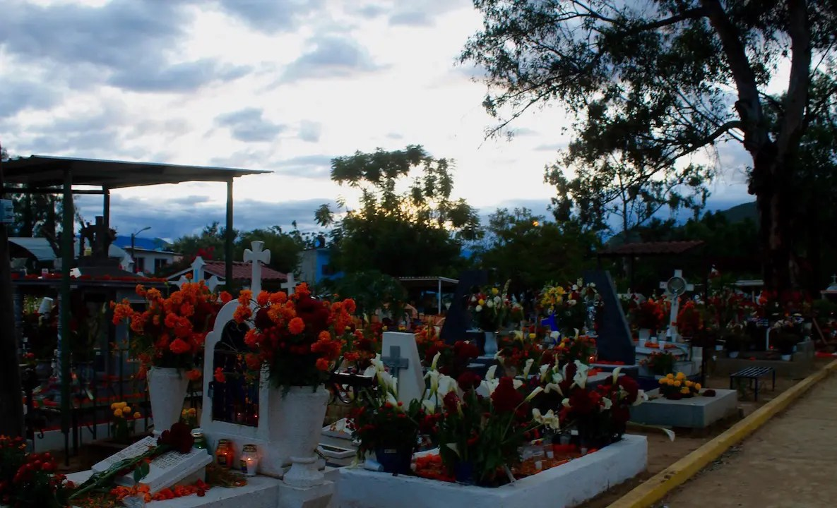 Cemeteries are where families gather to remember and celebrate with loved ones who have passed on during day of the dead in Oaxaca.