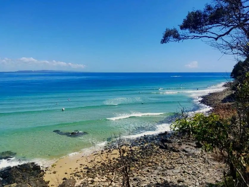 Surfers enjoying a perfect day in the stunning Noosa National Park, one of the best national parks in Queensland