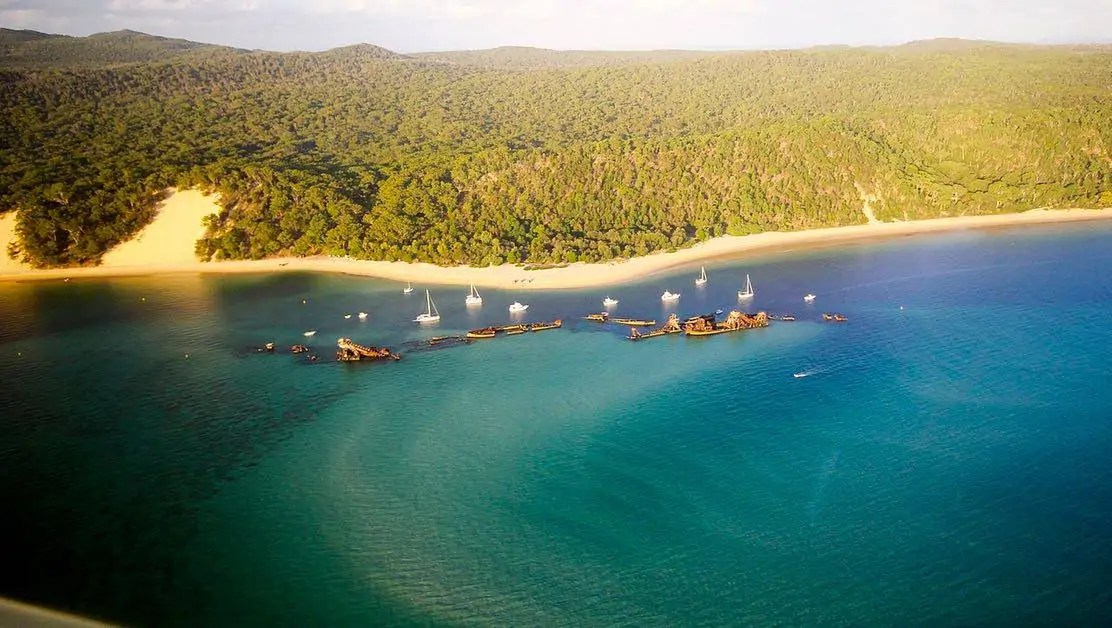 An aerial shot of the Tangalooma Wrecks off Moreton Island. One of the best national parks near Brisbane.