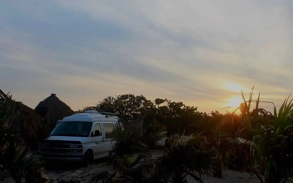 Campsite in El Cuyo, Yucatan Peninsula, Mexico. Is it safe to drive through Mexico at night? No, we think it is best to be parked enjoying a cold beer as the sun sets!