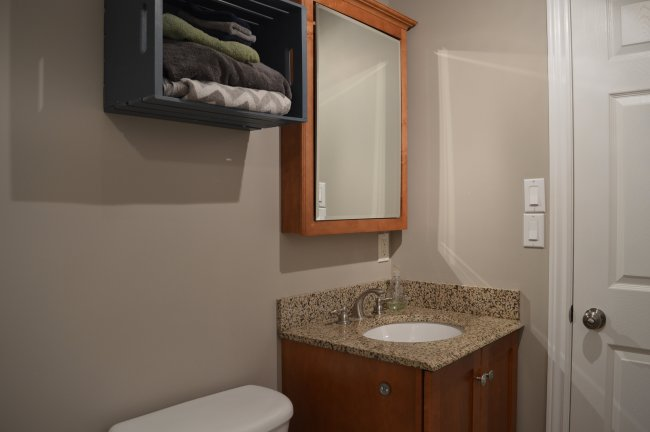 bathroom with apple crate shelf