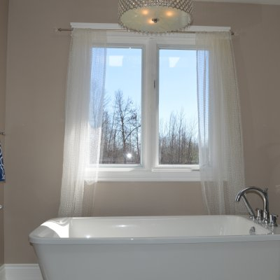 Main Bathroom and Family Room in a 1990s split-level