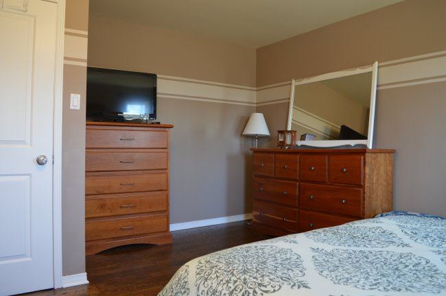 Master bedroom makeover with Minxwax Jacobean stain on the floors