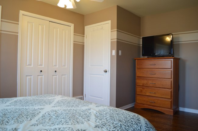 Master bedroom makeover with Minwax Jacobean stain on the floors