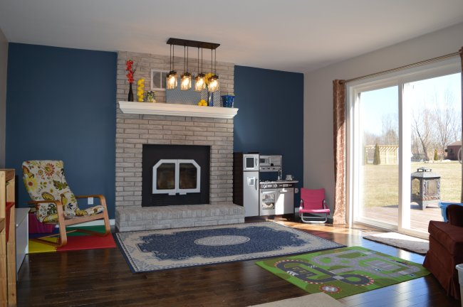 Fireplace room makeover with dark hardwood floors