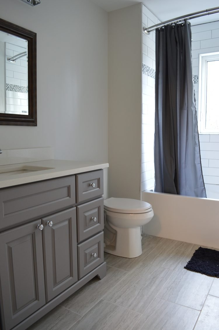 grey and white bathroom with white subway tile shower