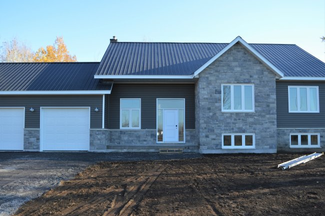 Raised bungalow with Permacon Lafitt stone in Newport Grey, and mitten siding in Rockaway Grey