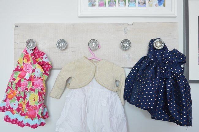 Display your baby girl dresses using vintage glass knobs