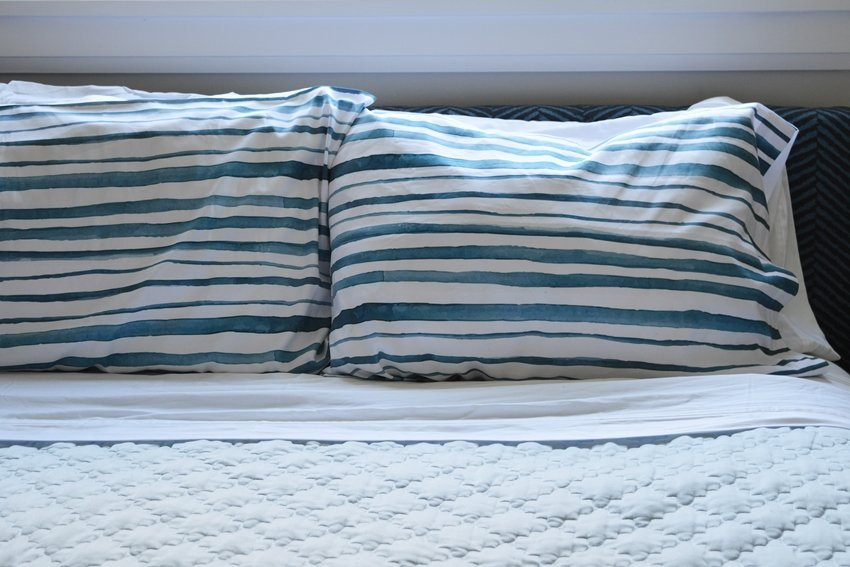 navy blue watercolor stripe pillowcase master bedroom linens