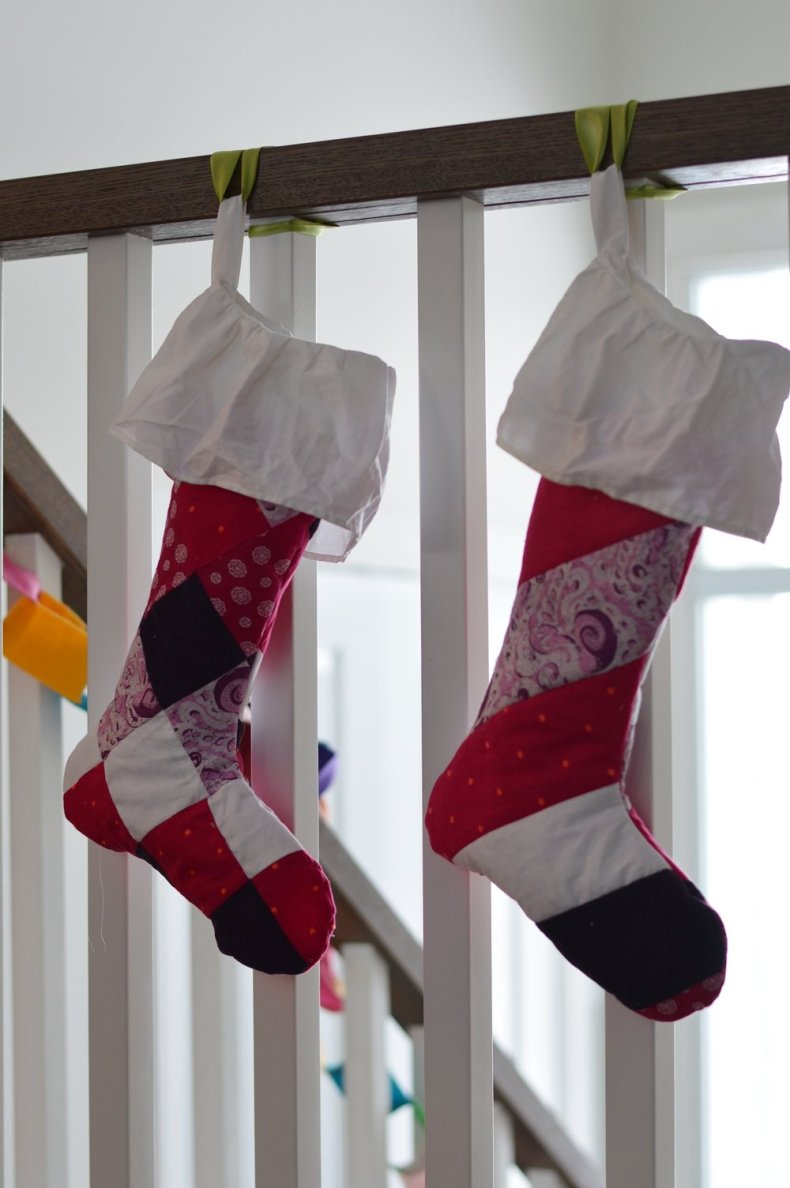 Quilted Christmas stockings made from baby clothes