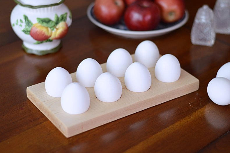 Display your farm fresh eggs or brightly colored Easter eggs with this DIY wooden egg holder! This makes a great gift idea. It is useful, practical, and looks pretty on a brunch table. #eggholder #easteregg #woodeneggholder #eastergift