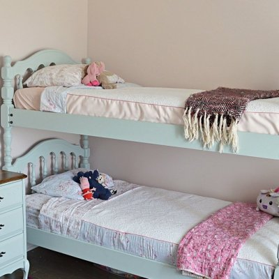 Painted blue spindle bunk beds for girls