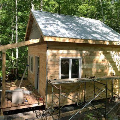 Pine cabin siding, interior trim, and kitchen cabinet doors