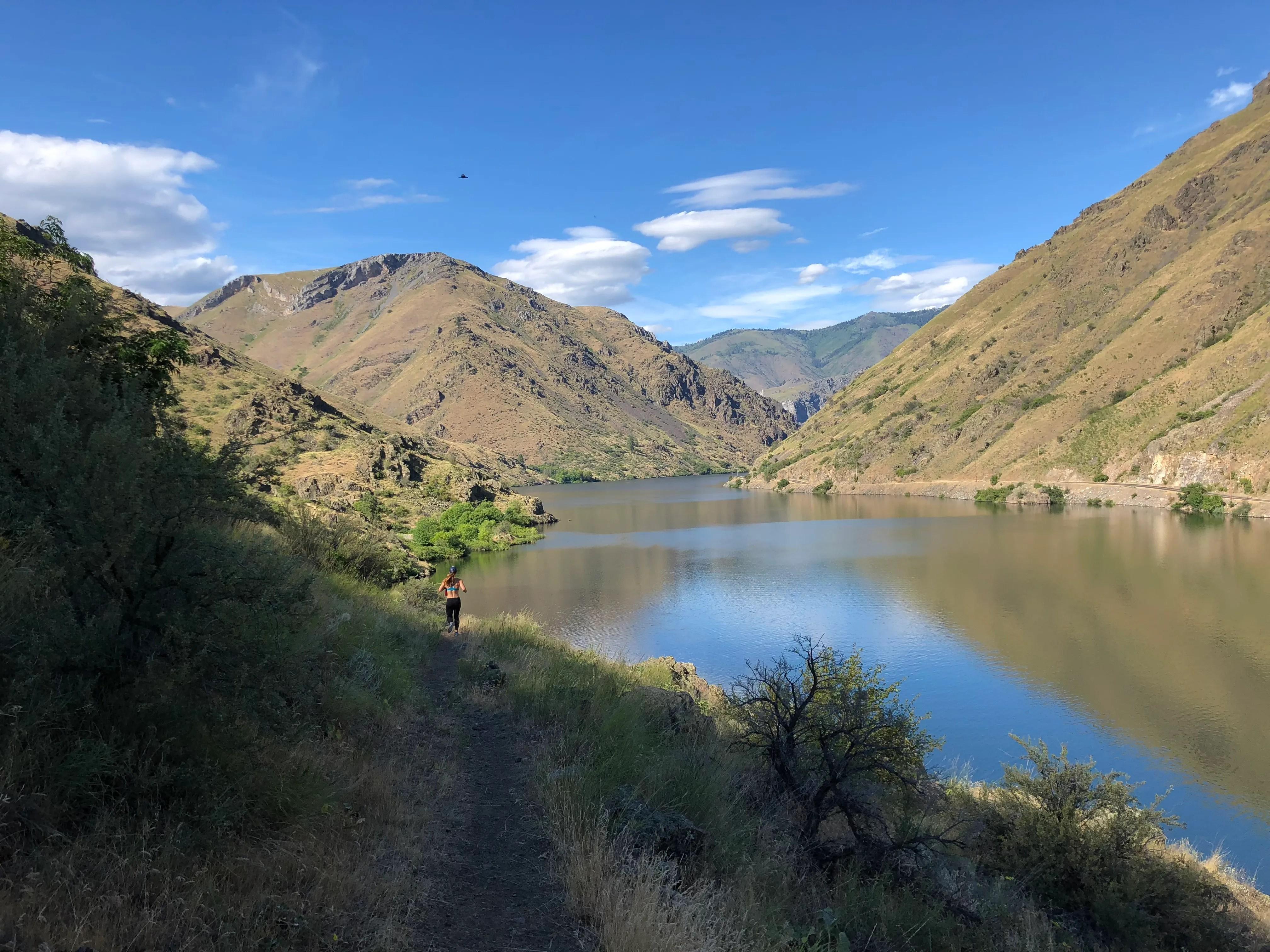 Emily Kramer running in Hells Canyon along the snake river
